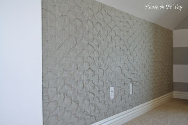DIY Fabric Covered Pin Board Wall made from foam board (cheaper than cork for larger spaces) covered in fabric.