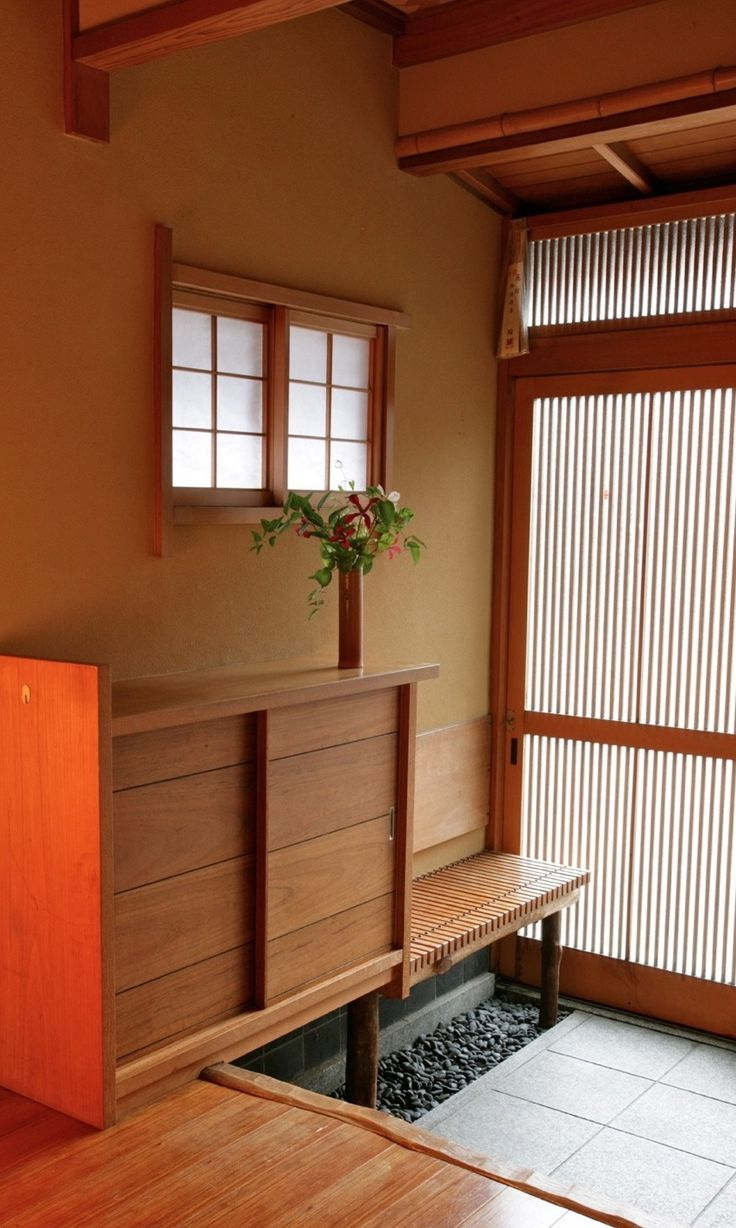 Genkan with storage and adjacent bench. Functionally works well. Would be great to have this on both sides of the entryway. Also like the feel of the pebbles indoors.