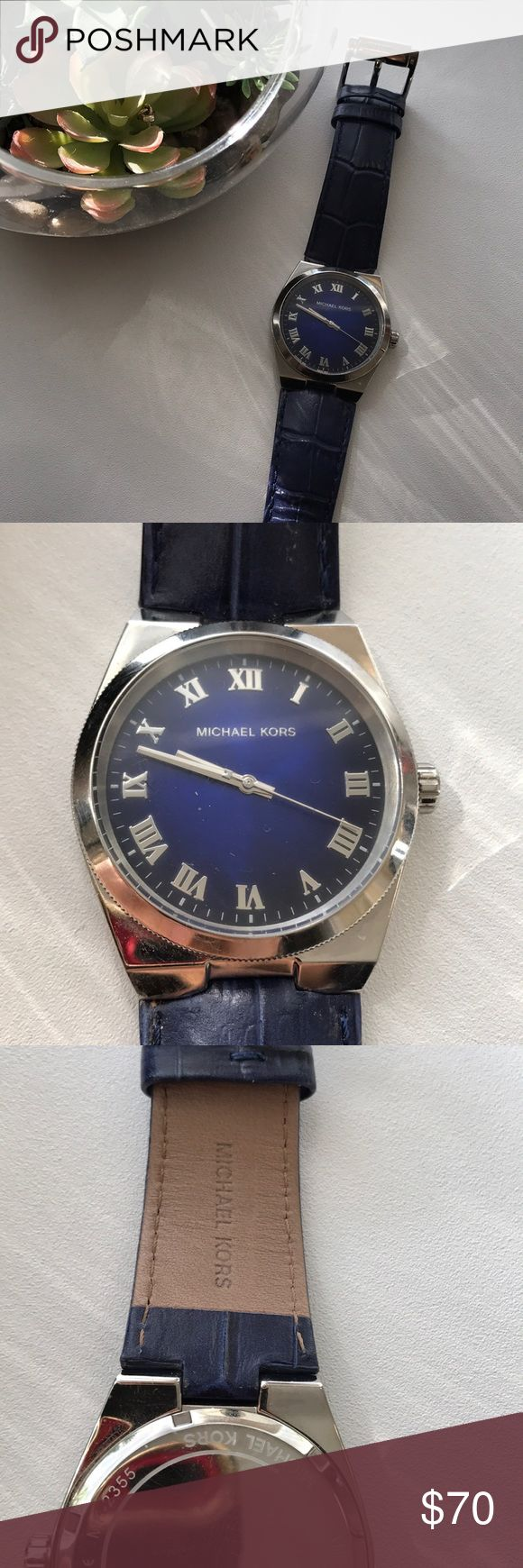 Michael Kors Blue Watch with genuine leather strap Micheal Kors Watch like new and only worn a few times. Excellent Condition. (Battery not included) KORS Michael Kors Jewelry
