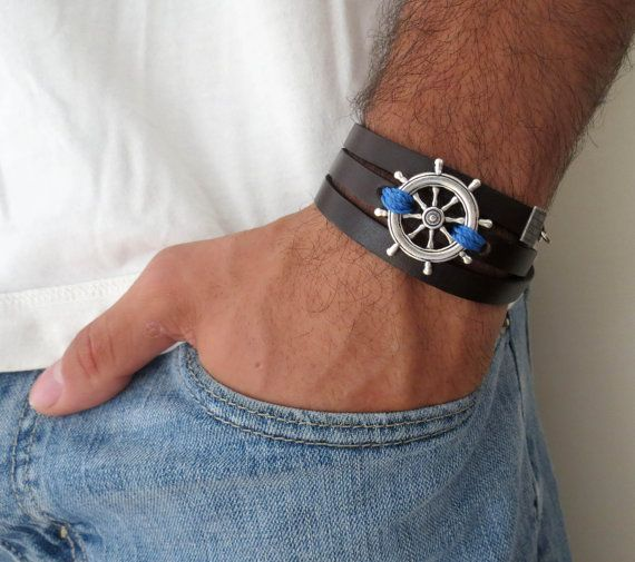 "Men's Bracelet - Black Leather Bracelet With Silver Plated Steering Wheel Pendant - Mens Jewelry - Mens Cool Jewelry - Gift for Him  Looking for a gift for your man? You've found the perfect item for this!   The simple and beautiful bracelet combines black leather which wrap 3 times on hand and a silver plated steering wheel pendant with a blue wire wrapped on it.  Lengh: 22.8 (53 cm) + 2"" (5 cm) extension chain.  $37"