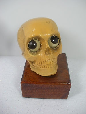 "Rare Vintage Oswald West Germany Rotating Eye Skull ""Time of Death"" Clock. Sold on ebay for $1,051.89"