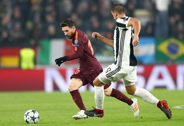 Lionel Messi of Barcelona and Sami Khedira of Juventus battle for possession during the UEFA Champions League group D match between Juventus and FC Barcelona at Allianz Stadium on November 22, 2017 in Turin, Italy. https://www.fanprint.com/licenses/akron-zips?ref=5750