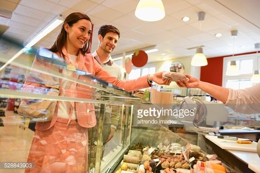 Customers Shopping At The Deli Counter In Organic Grocery Store ...