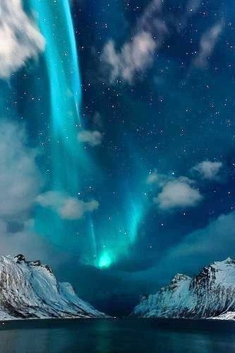 Northern Lights flash through the sky above glaciers- so serene!