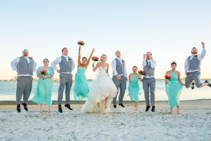 Wedding Fun with this jumping Bridal Party on the beach beside the Gulfport Casino in St. Pete.  Sandhill Photography, Wedding Photography, Teal, Turquoise, Aqua.
