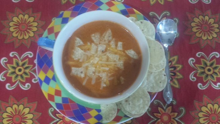 Chubby's homemade Taco Soup         1 ½ lbs. hamburger 46 oz. bottle V8 Juice 1 can diced tomatoes w/green chilies. 1 can Fiesta Nacho Cheese Soup + 1 can water. 8 oz. sour cream 1 pkg. taco seasoning mix. Mexican shredded cheese. 1 diced onion ¼ diced red pepper Instructions: Brown Hamburger, drain, add all ingredients, into crock pot, let simmer on low. Serve topped with Mexican shredded cheese and broken Tostitos or Fritos. YUMMO!