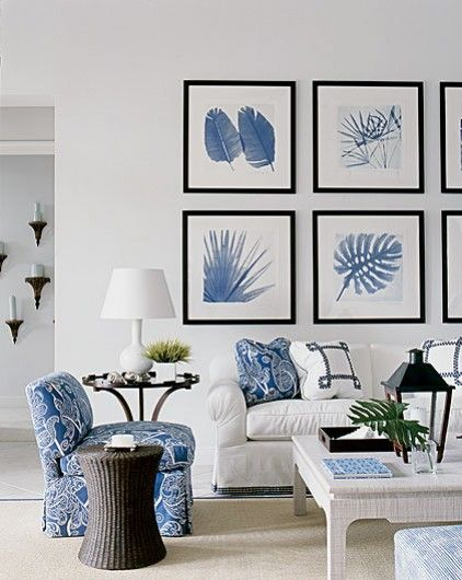 Blue and white used in both the artwork and soft furnishings make for a fresh, comfortable living room as featured in Weranda magazine