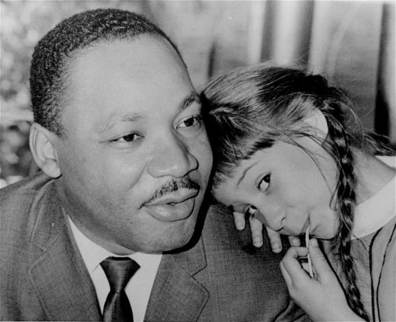 22-Little six year old Robin Arrington, daughter of a Miami Southern Christian Leadership Conference attorney, leans on Dr. Martin Luther King's shoulder as Dr. King holds a press conference, April 11, 1966, in Miami, Fl. Dr. King arrived in Miami for a meeting to establish a local chapter of his S.C.L.C. (AP Photo) / Beaumont