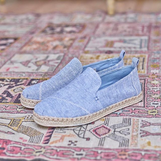 Blue Slub Chambray Women's Deconstructed Alpargatas: raw edges, chambray texture, a simplified structure and a blanket-stitch jute sole. #TOMS