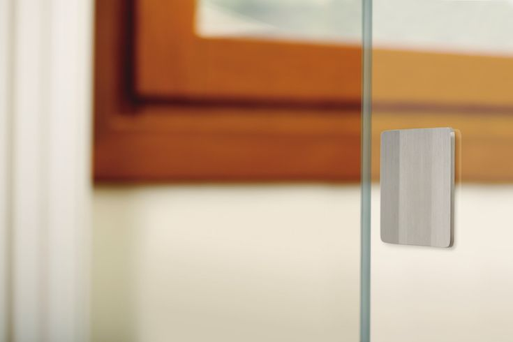 """Plec is a brushed, stainless steel handle, whose name means """"fold"""", it can only be made up of two symmetric folds where the opposite ends are ever so slightly elevated. It is available in a square shape 50x50mm and 75x75mm and in a rectangular sha"""