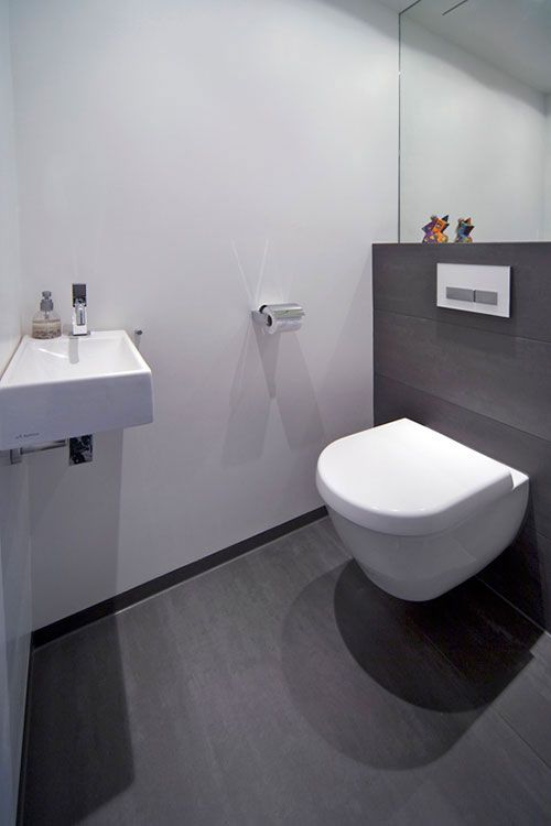 Modern toilet...like how the toilet is not touching the floor.   possible for boys bathroom