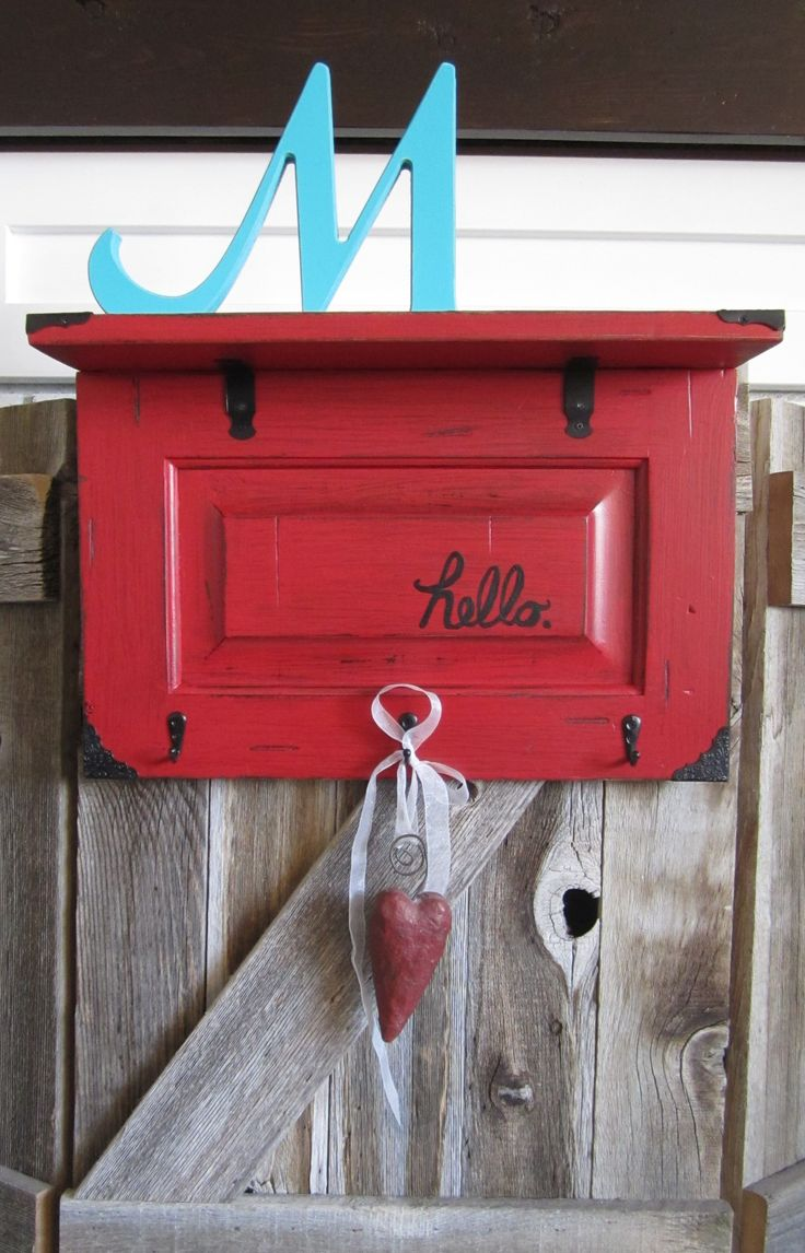 """hello"" shelf in red made from old cabinet door"