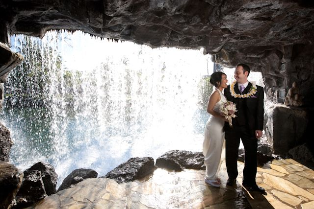 not many couples can say that they have a wedding photograph from behind a waterfall so fun that the hilton waikoloa gives you the option to walk