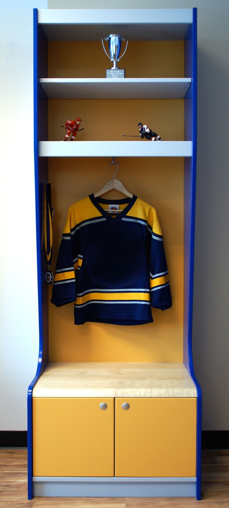"Sport Locker- Yellow, Grey and Blue     Sport locker for your kids room, game room or garage. Sport Interiors creates high quality sports sport furniture and accessories. We can customize our products with your team's favorite colors! Made in the U.S.A.  Does not include tax or shipping!    Product Attributes:     Base Model:  • Dimensions: 28""x84""x22""  • Solid Maple Seating Bench  • Doors on Lower Shelf  • Flush Faced Door Handles  • Three Shelves  • Jersey Hooks  • Hardware"