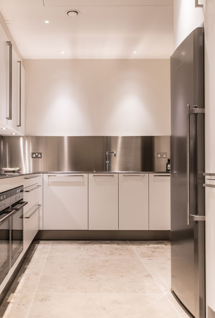Stainless steel splashbacks - stainless steel everything - uber modern kitchen.