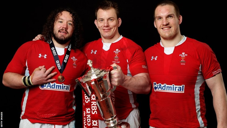 The Welsh front-row – Adam Jones, Matthew Rees and Gethin Jenkins – pose with the Six Nations trophy