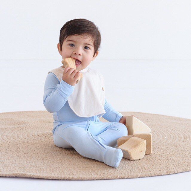 """Our ultra-soft Bib is there to pick up the mess, no matter what your baby decides to call """"food."""""""