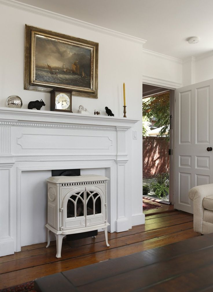 Jim & Laura's Light-Filled Providence Colonial- wood stove in front of fireplace is really cool