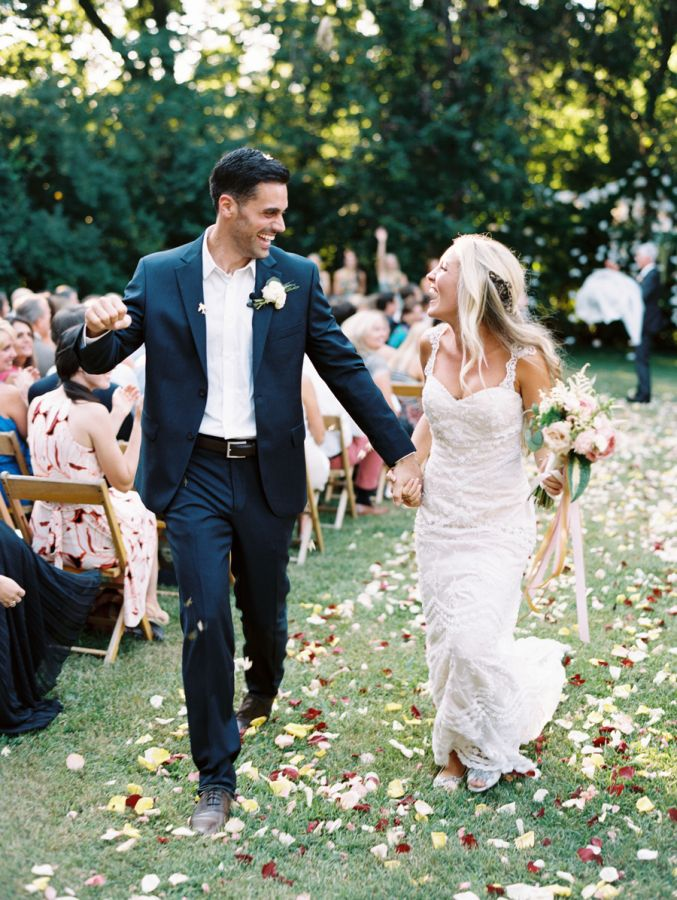This outdoor garden wedding moment is pure bliss! http://www.stylemepretty.com/2015/11/16/sweet-summer-garden-wedding/ | Photography: Nina and Wes - http://ninaandwes.com/