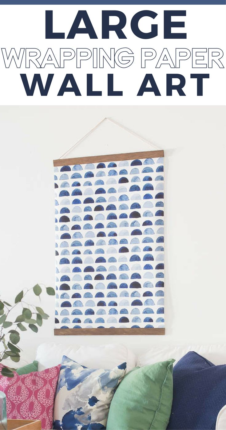 How to make large wall art for cheap using wrapping paper and scrap wood.