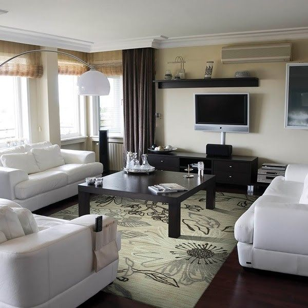 Transitional/floral area rug that puts beautifully together a living room with neutral color furniture