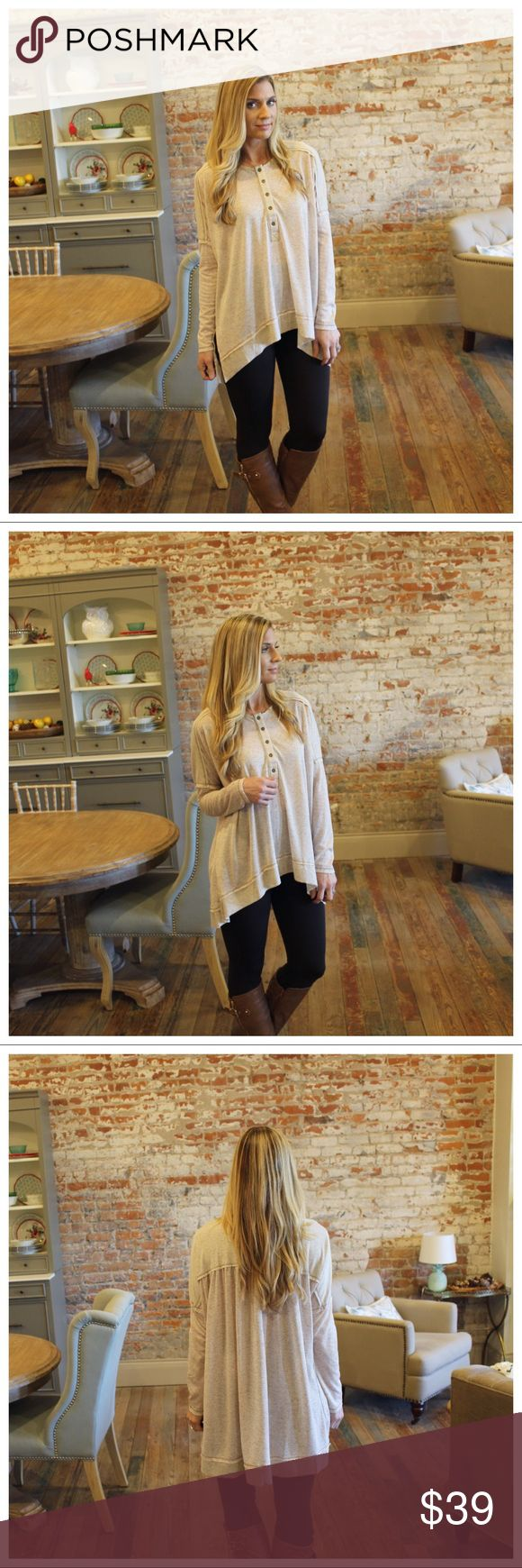 "Beige button up slouchy henley high low tunic Modeling size small.  92% polyester 8% linen.  Bust laying flat (dolman sleeve) S 26"" M 27"" L 28"" Length S 27/32"" M 28/33"" L 29/34"". Add to bundle to save when purchasing.  FG9221201.HT10040 Tops Tunics"