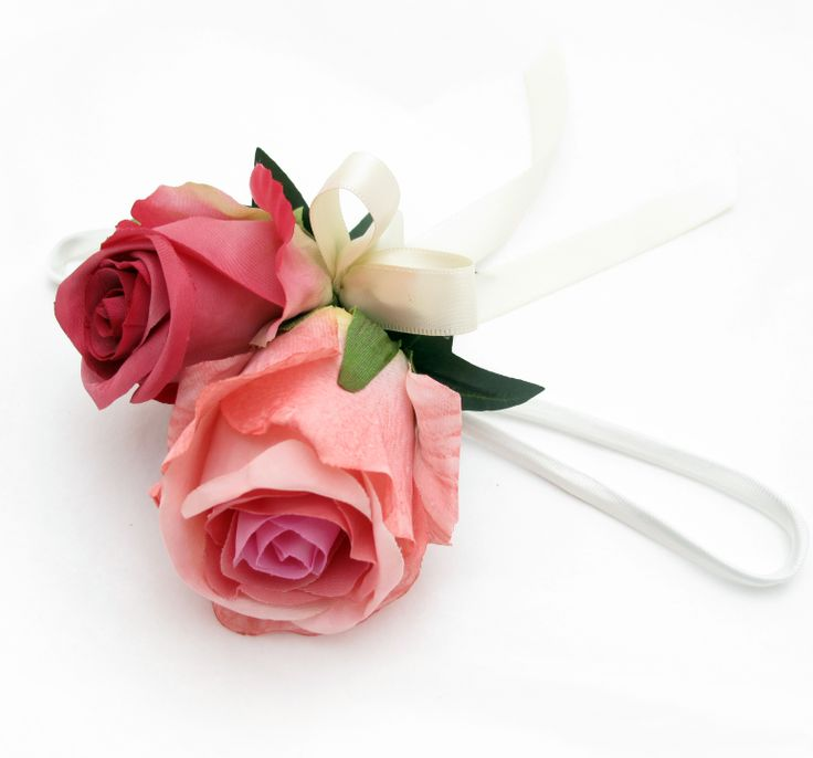 A deep pinks garden roses wristlet. Find your perfect wedding flowers at www.loveflowers.com.au