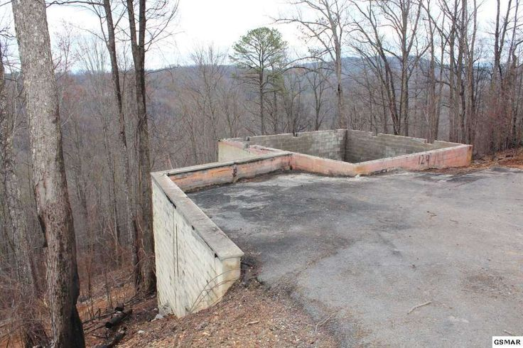 Ready to build your ... new cabin! Lot with seasonal mountain views less than 10 minutes from the city limits of Gatlinburg.  Lot had a 1 bedroom structure that was destroyed by the wildfire. The foundation, shared well and septic system are still in place. Septic installed with a one bedroom permit.  Buyer should have property independently inspected and check with building authorities regarding permits needed for reconstruction. Structural Engineerâ⿬⿢s report, septic inspection…