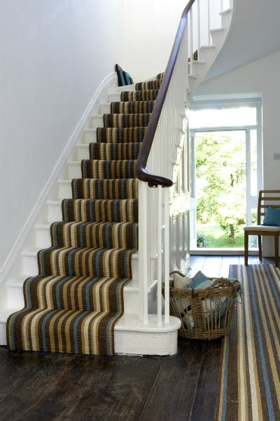 White stairs , banister matches the runner