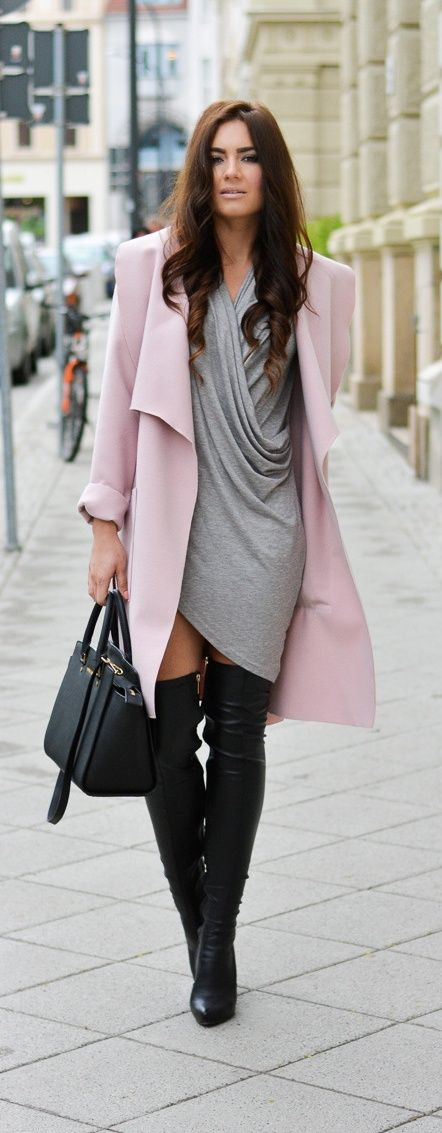 Pastel coat with wrap dress and over the knee boots probably draws a lot of attention.