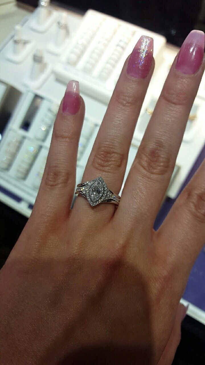 Marquis center cut with subtle double halo for added beauty. Split shank studded band for elegance. Engagement with sophistication. Contour bands for contrast.