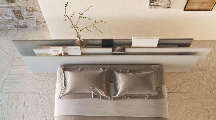 The Vele Bedheadboardis made up of threefabric- or…
