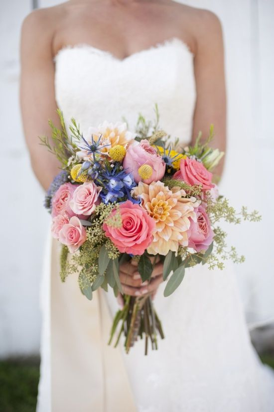 Bouquet contains Garden Roses, Dahlia (large peach bloom, these are unavailable sept), Billy Buttons, Native Seas Holly, Blue Bells and assorted foliage...some native Australian