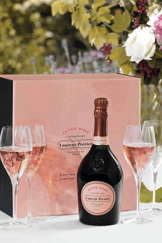Happiness in a bottle. Laurent- Perrier Pink Champagne! It's like drinking little bubbles of love! Bottoms Up!