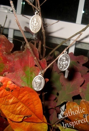 """Make and All Saints' day """"tree"""" with Saint medals. What a cute idea!"""