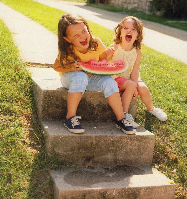 Oh sure make me laugh now because my cute face is about to be pushed into that nice big piece of watermelon!