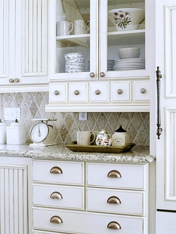 Make cabinet with pocket doors with a granite top for coffee maker and toaster?