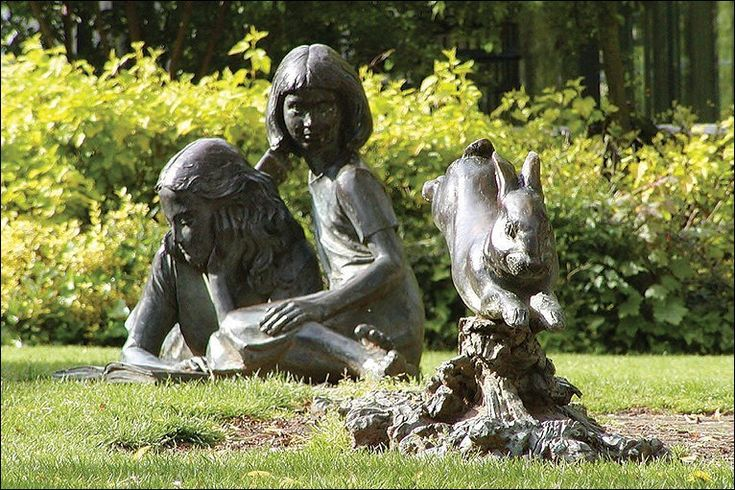Sculpture of Alice (and her sister) and the White Rabbit - by Edwin Russell;  in Guilford, England