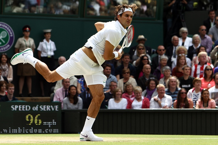 Roger Federer serves to Andy Murray during the Men's final on Centre Court.