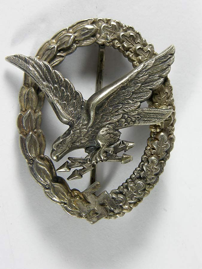 Luftwaffe Wireless Operator qualification badge by Berg Nolte Ludenscheid. This early war example still retains traces of its original frosting on the wreath. The heavy nickle silver badge displays excellent detail. The reverse features the BN L maker's mark.