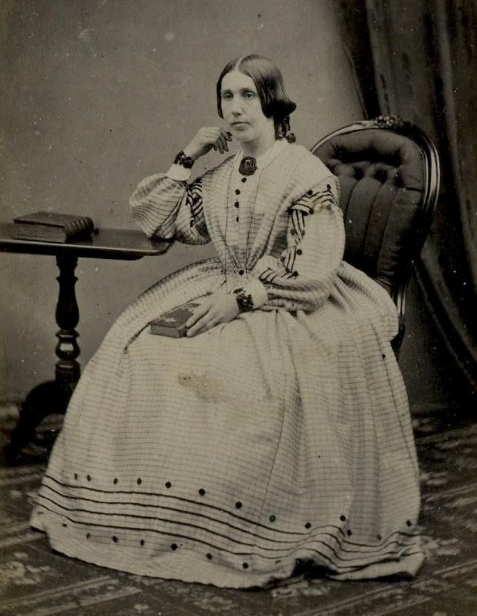 An 8.5cm x 5.5cm carte de visite image of a seated woman wearing a hooped dress with embroidered hem. Photographed by M.A.Dodds of 53 Queen Street, Wolverhampton. Circa 1860. | eBay!