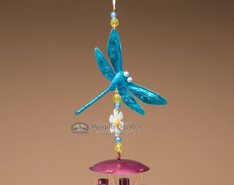 This is a classic hand painted southwestern wind chime with a classic look for garden or patio. This wind chime is adorned with a hand painted metal designer dragon fly at both the top and bottom, per