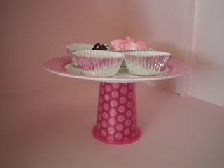 Cute idea to organize accessories in a girl's room...DIY sippy cup cake stand and cupcake liners
