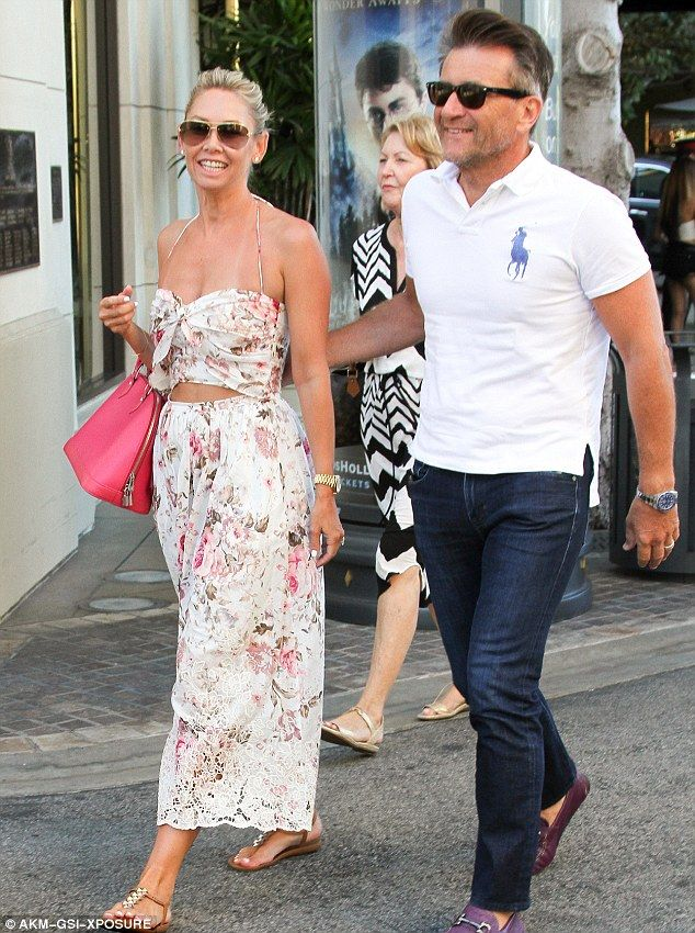 Fresh tans: The couple were at The Grove after a honeymoon in the South…