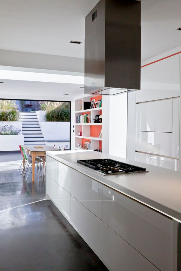 Pigmented polished concrete floor Corian and parapan Kitchen