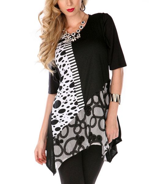 Boost any wardrobe with this sassy tunic. Featuring medley of spots and stripes, it's sure to become a fast favorite.
