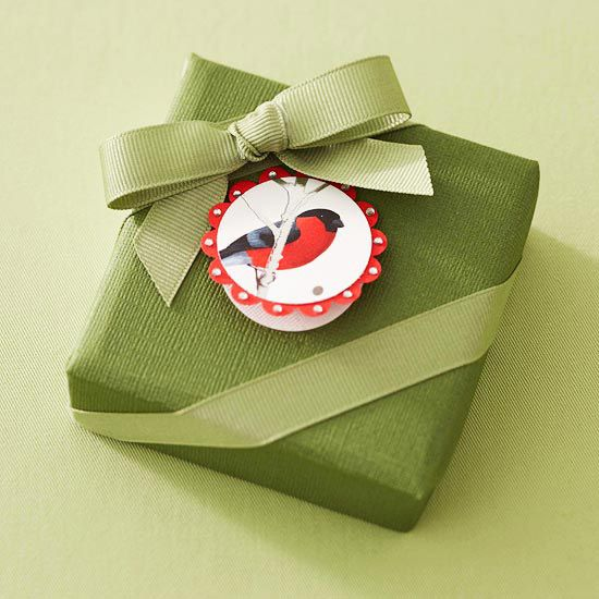 recycle greeting cards to make gift tags. use a 1 1/2 in circle punch, puch decorative portion and a scallped circle from red cardstock.
