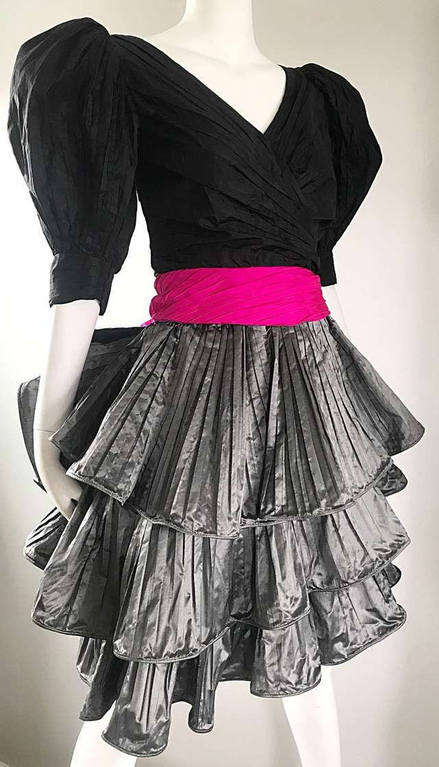 b1745c0bf90 For Sale on 1stdibs - Sensational vintage PAUL LOUIS ORRIER Couture 1980s    80s silk taffeta cocktail dress! Features a black fitted pleated bodice  with ...