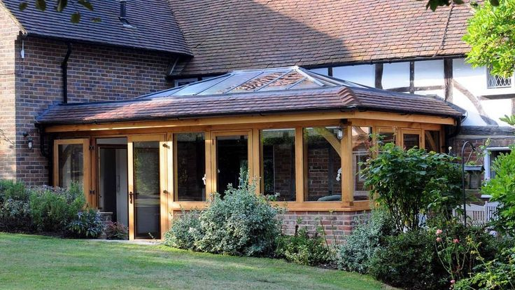 Oak extension with tiled roof and glass lantern