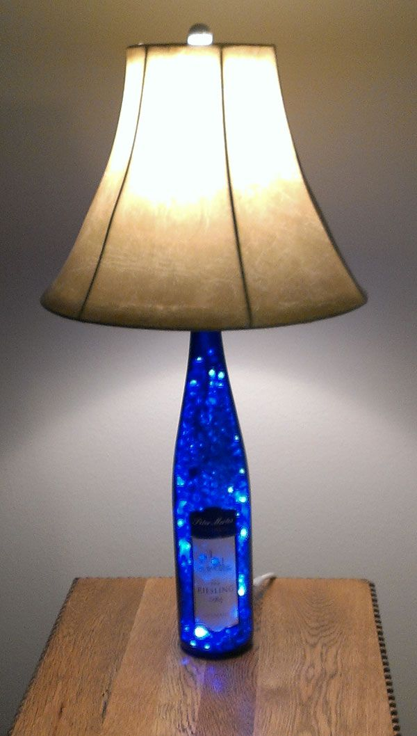 Blue wine bottle lamp...this would be awesome with a really big glass jug....holiday lights inside act as a night light and then traditional lamp light on top!!!....I'm making one out of an old large bottle, will post when done :)